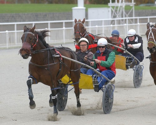 Racing Minister Damien O'Connor (right in front sulky), takes the